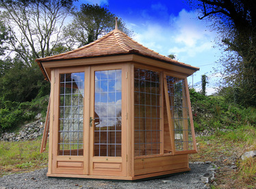 Beautiful custom made Garden Rooms | Western Red Cedar | Supply + Fitted by Owen Chubb Garden Landscapers.