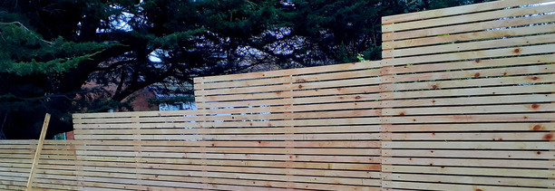 Custom made Timber Fencing featuring timber slats in a Rathfarnham Garden, Dublin 14 | Owen Chubb Garden Landscapers
