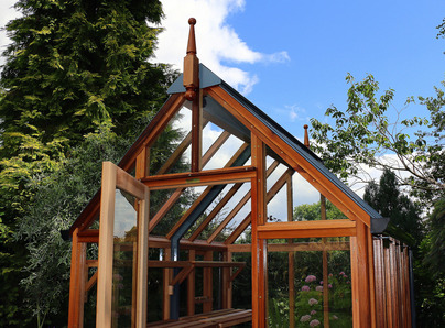 RHS Rosemoor Greenhouse with cedar base panels - traditional Victorian timber Greenhouse