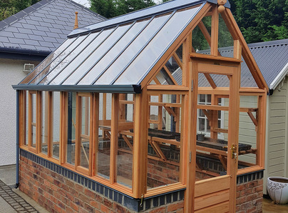 RHS Rosemoor Greenhouse on dwarf wall - traditional Victorian timber Greenhouse
