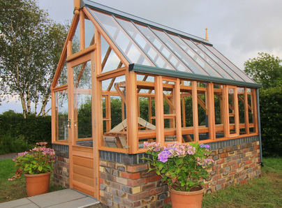 RHS Hyde Hall Greenhouse on dwarf brick wall - traditional Victorian timber Greenhouse