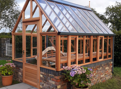 RHS Hyde Hall Greenhouse on dwarf wall - traditional Victorian timber Greenhouse