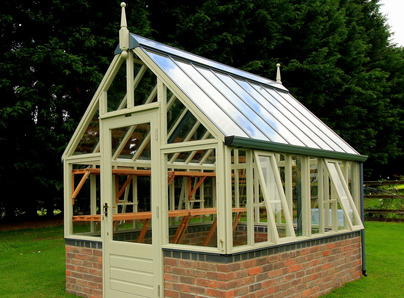 Painted RHS Hyde Hall Greenhouse on dwarf wall - traditional Victorian timber Greenhouse