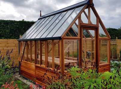 RHS Hyde Hall Greenhouse with UV timber protection - traditional Victorian timber Greenhouse