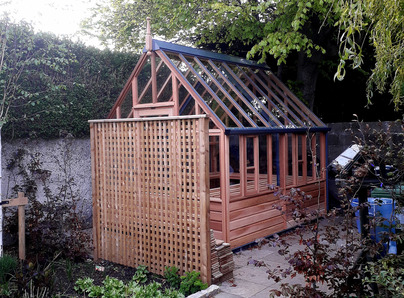 RHS Wisley Greenhouse with cedar base panels installation in Sandymount, Dublin 4.