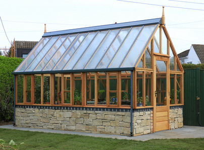 RHS Wisley Greenhouse on low stone wall - traditional Victorian timber Greenhouse