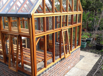 RHS Wisley Greenhouse on dwarf wall - traditional Victorian timber Greenhouse